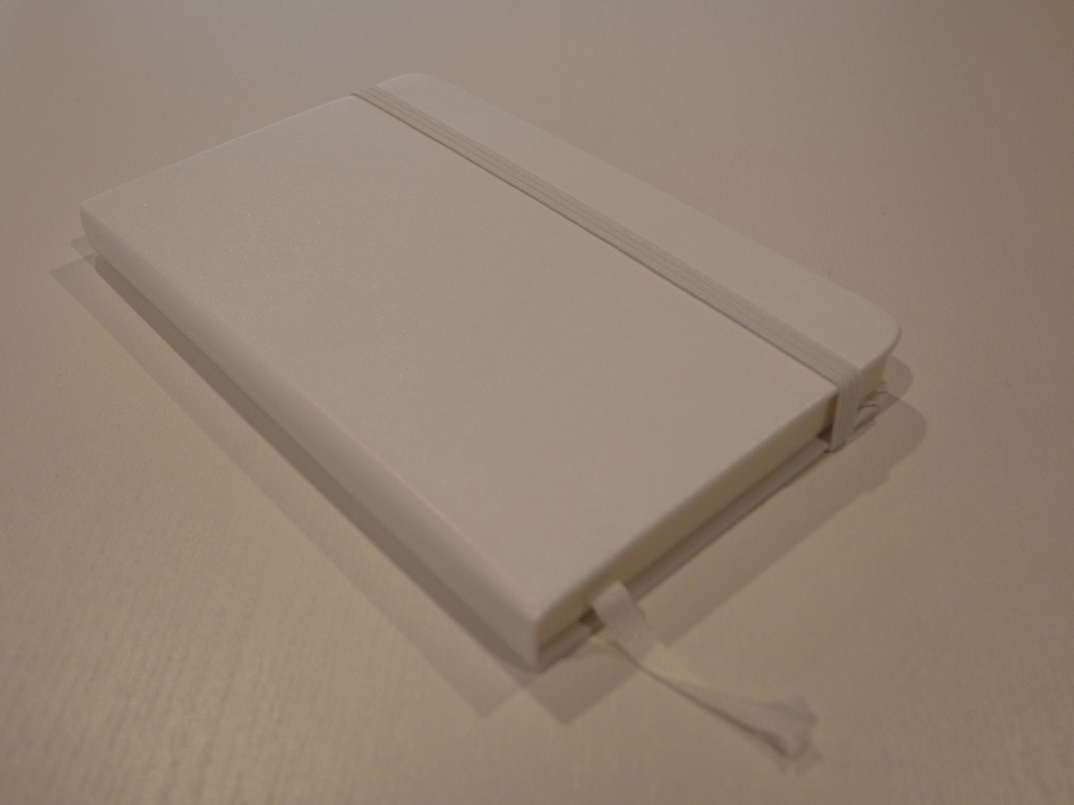 Moleskine white pocket plain notebook