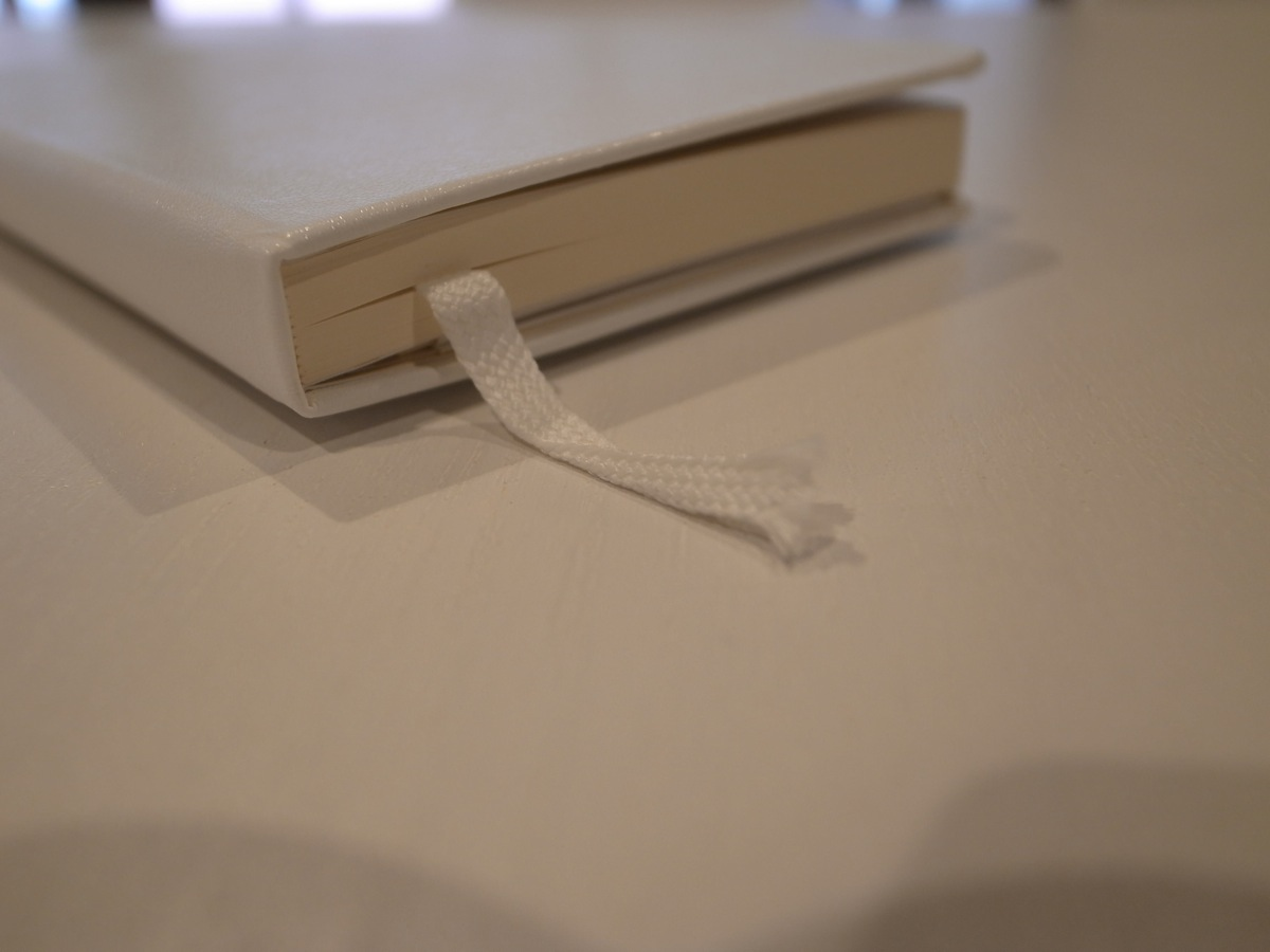 Moleskine white pocket plain notebook 4